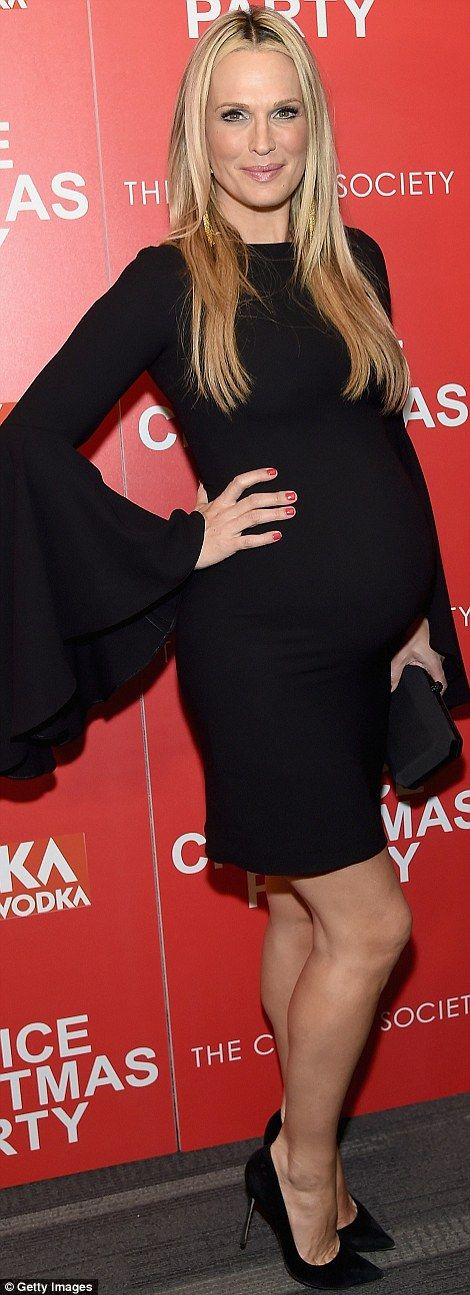 Matching up:Like Aniston, she'd picked a black clutch for her accessories, but unlike her...