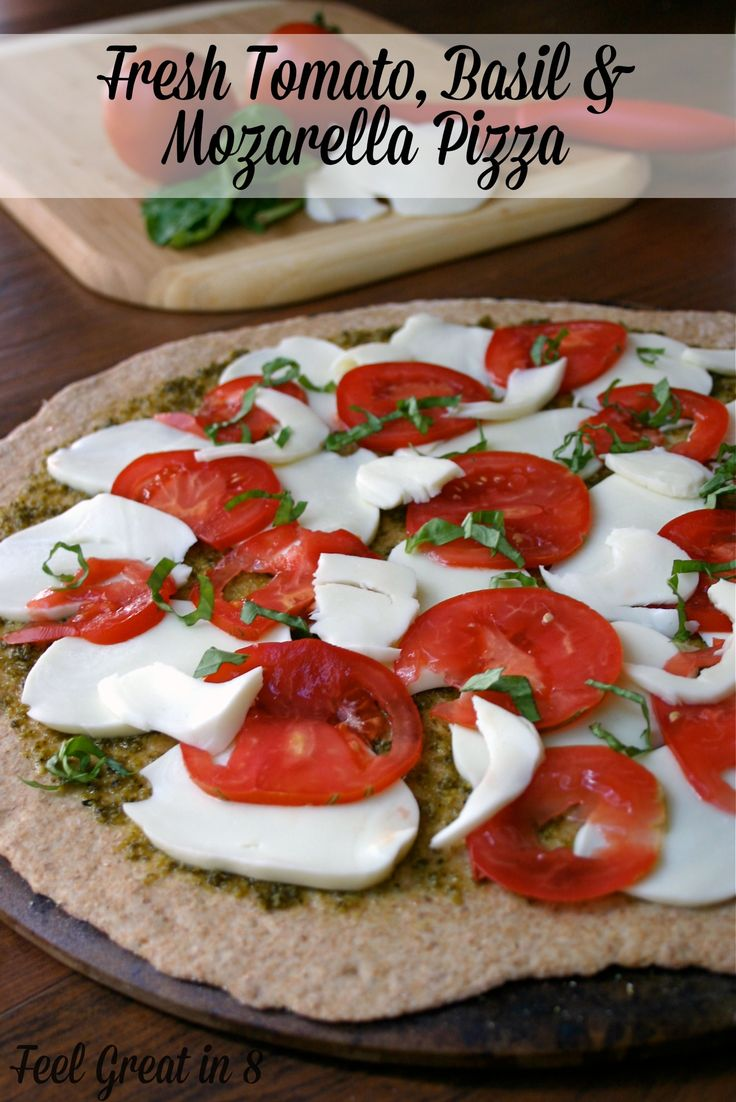 It doesn't get much better than pesto, tomatoes and fresh mozzarella cheese on a nutty whole wheat pizza crust! Feel Great in 8 #healthyrecipe #pizza #tomatoes