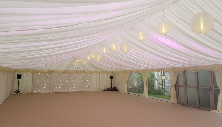Ivory globe lanterns with starlight backdrop by www.24carrotevents.co.uk