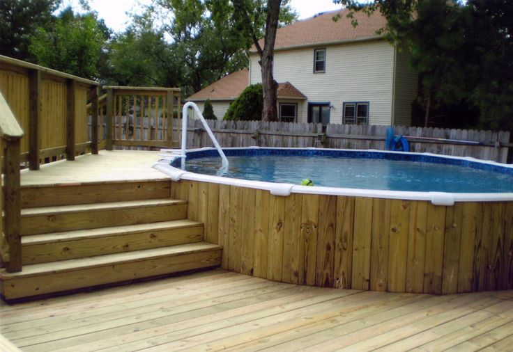 Above Around Pools with Decks in a Vintage Mood : Natural Wooden Look Circle PoolWhite Wall House Above Ground Pools With Decks