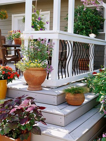 """Curvy and Cool """"A sharp black-and-white color scheme defines this railing, which features curvaceous aluminum balusters. This railing design eliminates the confined feeling that bulky wood balusters can create."""""""