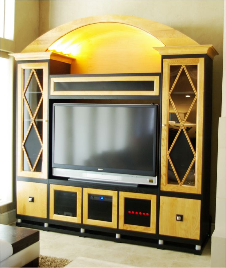 Natural Maple Wood Entertainment Center With Black Lacquered Oak Trim And Overhead Lighting All