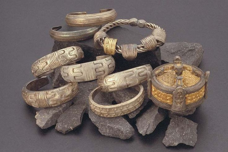 A Viking jewellery treasure found in Grötlingbo parish on Gotland, Sweden. The big box brooch is decorated with gold leaf, the heavy arm rings feature elegant stamped ornamentation. On a wrapped bangle there are finger rings in gold and silver.