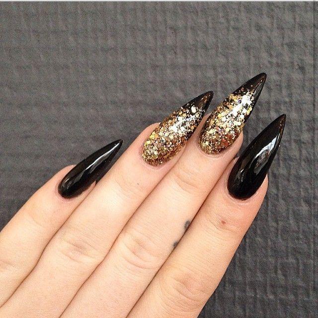 Looks pretty with silver glitter also.... Black stiletto nails with gold glitter