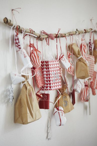 Inspiration: Christmas advent calendar numbered packages tied to a branch. From…