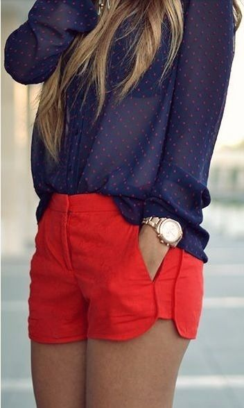 Red high waisted shorts and polka dot blouse
