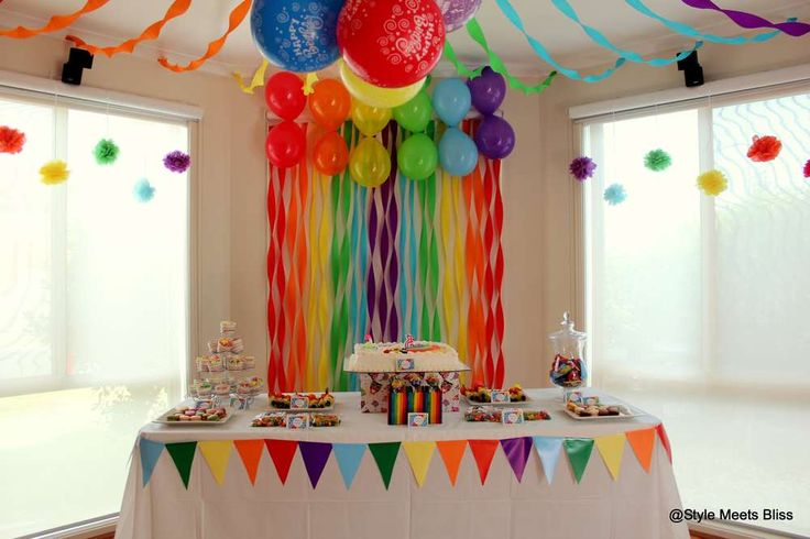 Rainbow birthday party, balloon backdrop and dessert table! See more party ideas at CatchMyParty.com!