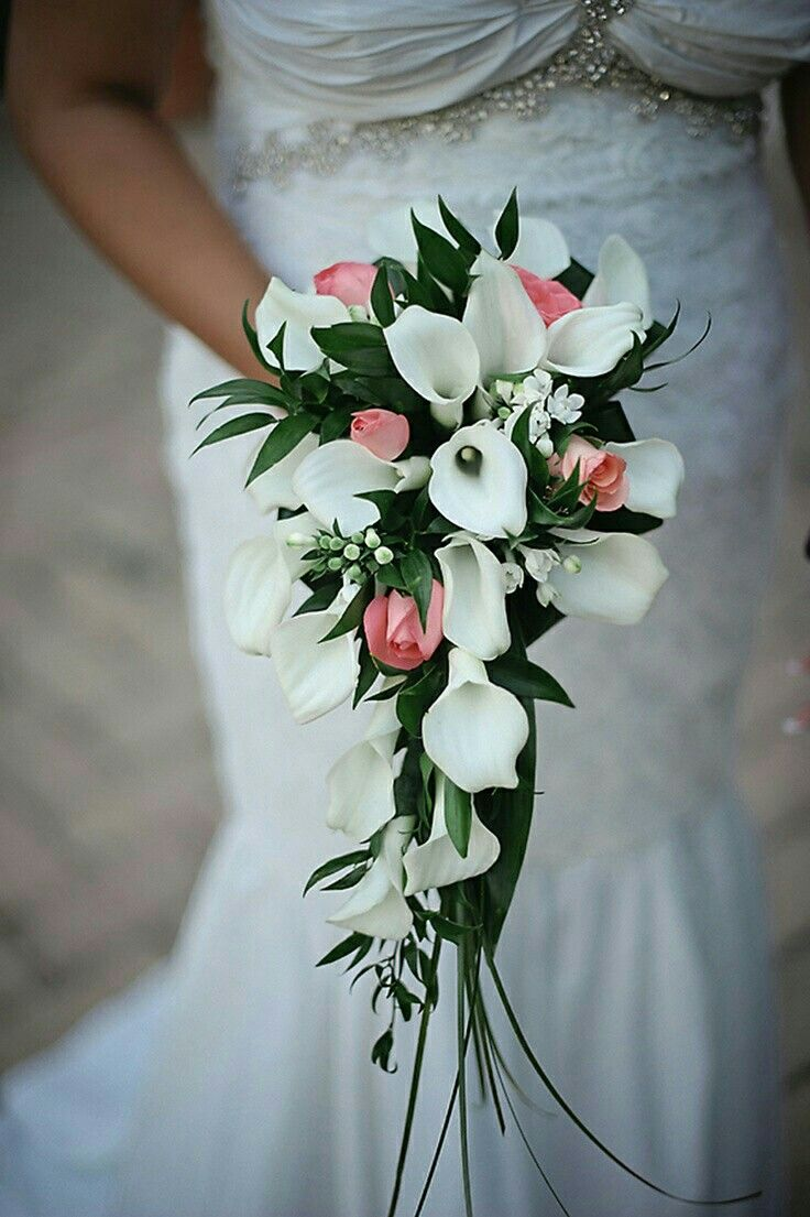 """Elegant & Petite Cascade Bridal Bouquet Comprised Of: White Calla Lilies, White Bouvardia, Coral/Pink Spray Roses, Green Bear Grass + Other """"Tropical"""" Greenery/Foliage"""