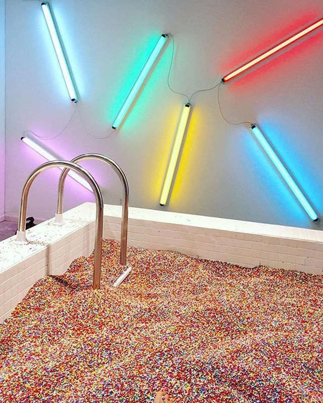 Ice cream lovers, add this to your 'I want to go there' list. The Museum of Ice Cream has now opened in New York, and it's everything we dreamed of: a room that smells like chocolate, futuristic ice cream innovation, edible balloons, a wall of ice cream cones, and A POOL FILLED WITH SPRINKLES.