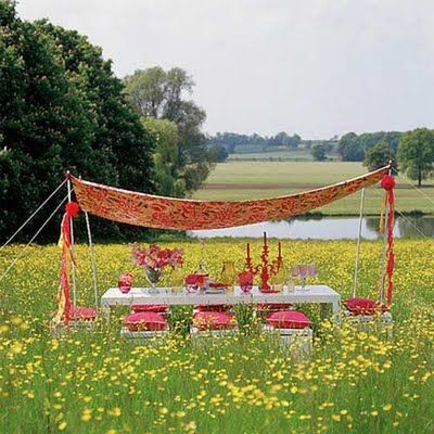 4 PVC poles or metal poles - fabric of your choice (you could use a tablecloth, sheet, or cut fabric) - streamers - table and chairs (or whatever you have on hand. Be creative!) - colorful table settings, pillows, accessories