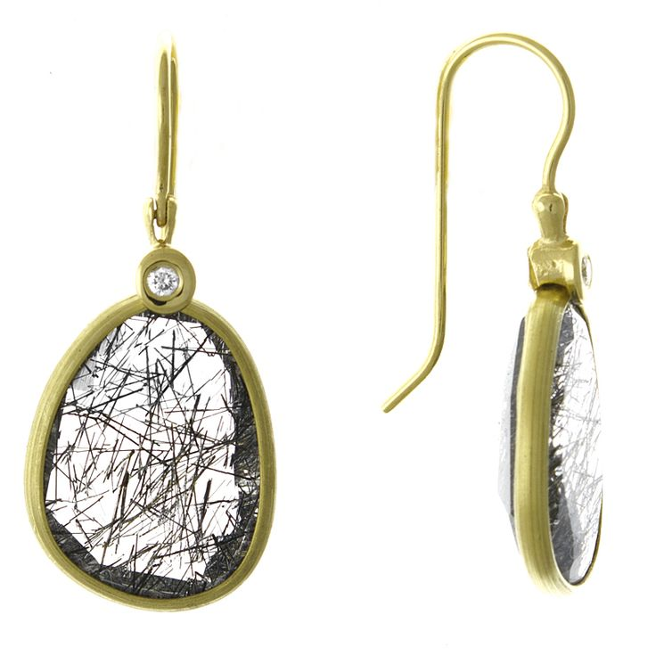 Pair of oval shaped, rutilated quartz earrings with bezel set diamond earrings. Combined diamond weight is 0.04 carats. French wire findings. Unique.
