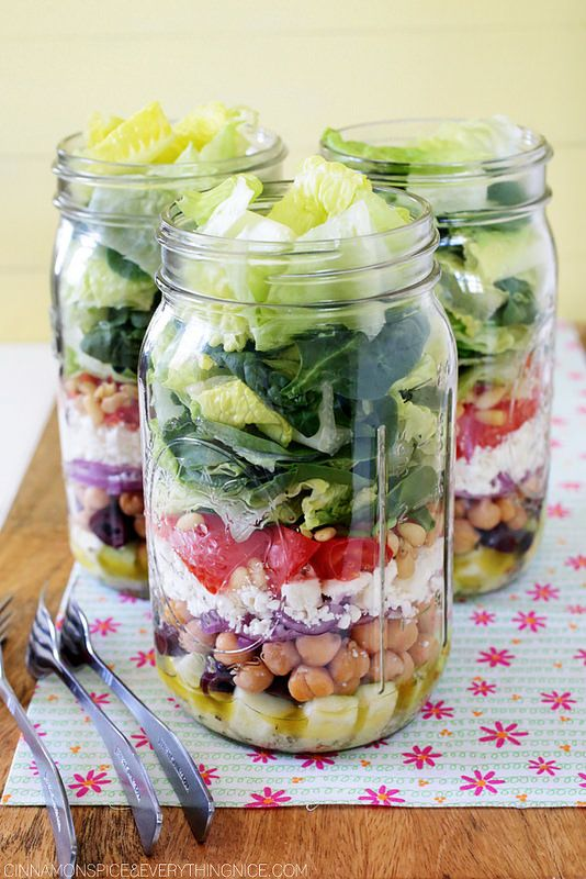 Mason Jar Greek Salad Recipe (veg) 1.Lemon vinaigrette/dressing 2. raw zucchini 3. kalamata olives 4. chickpeas 6. crumbled feta cheese 7. tomatoes 8. pine nuts 9. romaine hearts and baby spinach