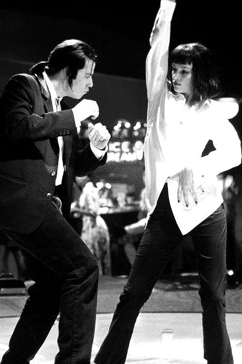Vincent and Mia doing their thing at  the worldfamous Jackrabbit Slims twist  contest- Pulp Fiction
