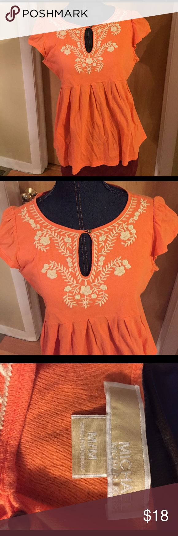 Michael Kors orange short sleeve shirt Cute orange Michael Kors shirt sleeve shirt with elegant neck line.  Clean and in great condition from a smoke free house! MICHAEL Michael Kors Tops Tees - Short Sleeve