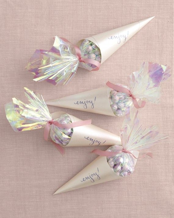 The next best thing to ice cream cones? Candy cones. We used Pearl White mini milk chocolate balls, iridescent film, metallic opal paper, and ribbon to create these gorgeous, girly favors with ultimate shine.