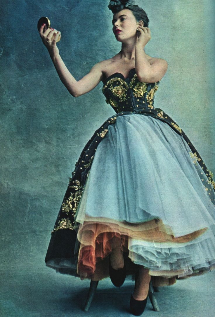 Model photographed by Irving Penn wearing a dress by Christian Dior, 1950