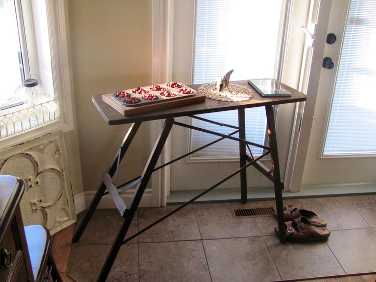 Antique ironing board serves also as a charming decorative piece .
