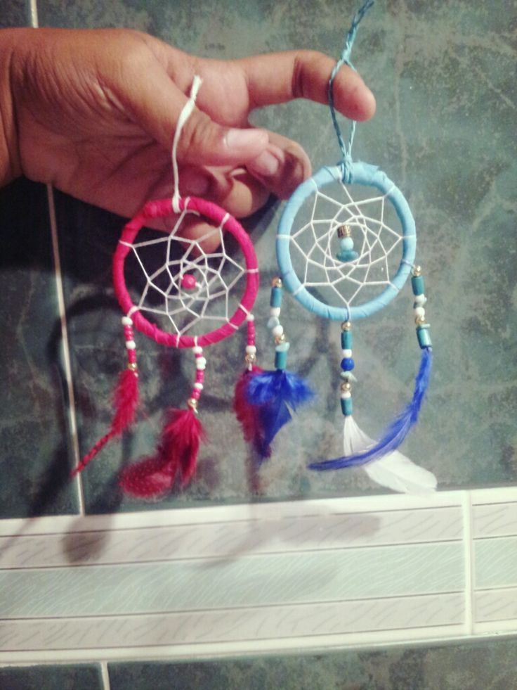 Small handmade dreamcatcher hangers :) These are very cute :) I used embroidery threads, beads,feathers