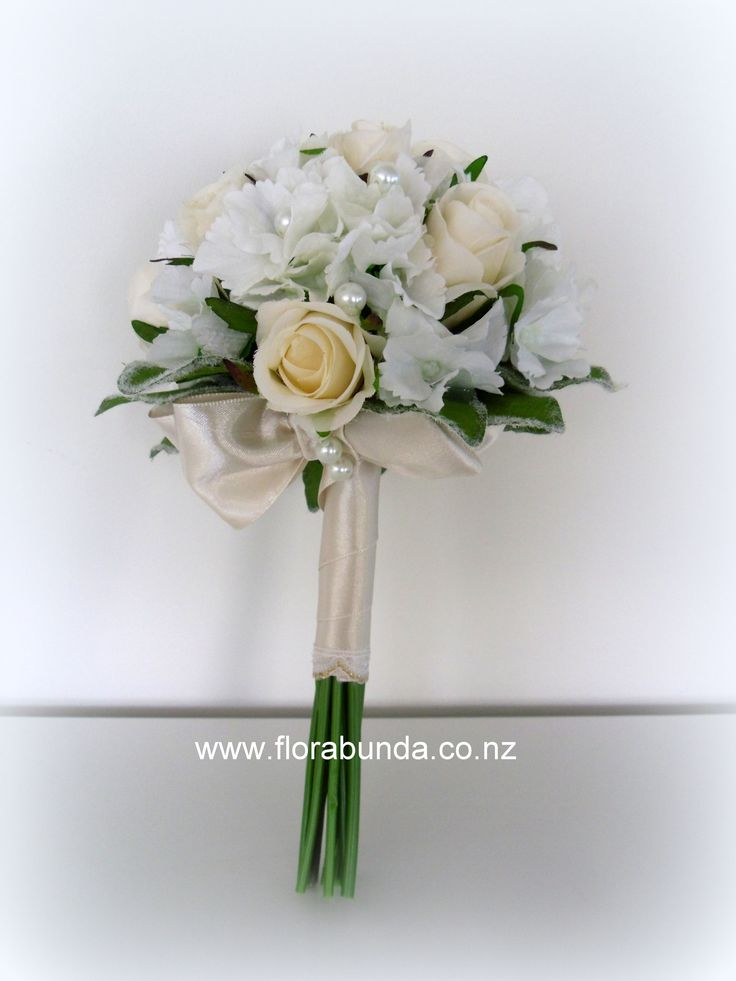 pearls adorn this champagne and white pretty posy in artificialflowers