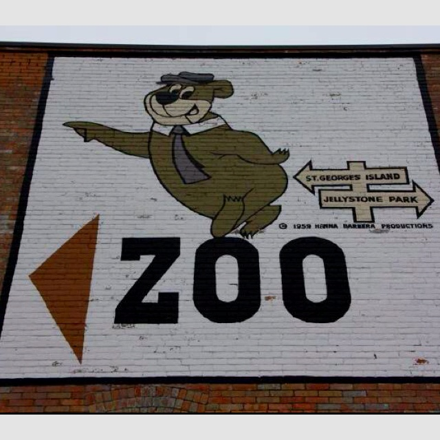 Yogi the bear pointing in the direction of the Calgary zoo  I don't think this sign is there anymore, down in Inglewood.
