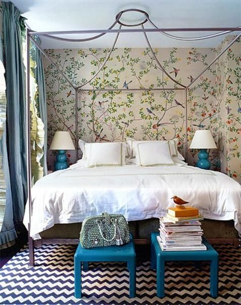 Bedroom decorating with window curtains, turquoise blue lamps and stools and flower wallpaper in matching colors