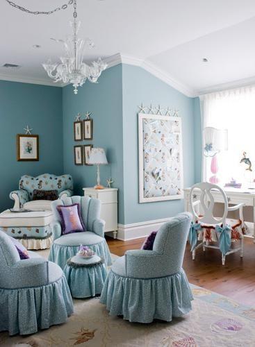 Shabby coastal style with beach rug.   Love the various fabrics on the chaise.