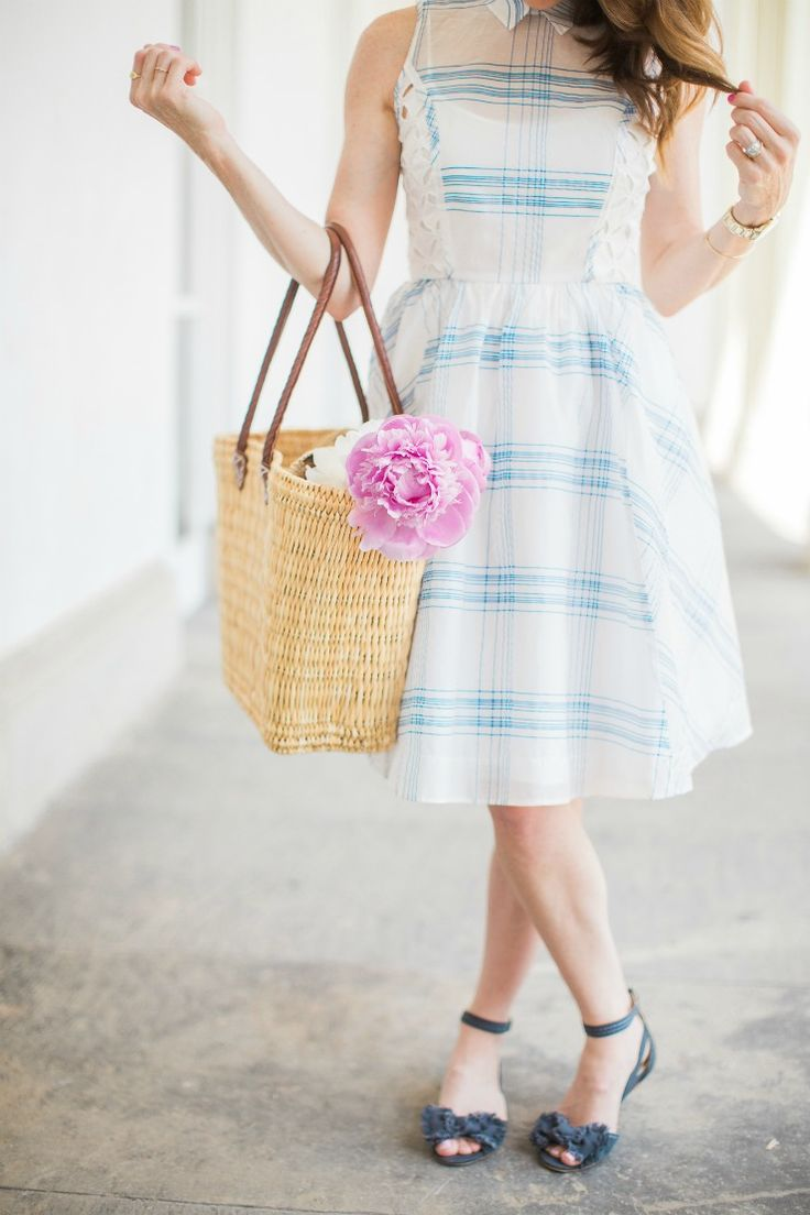 Looking for the perfect summer outfit? Art in the Find shares a blue and white eyelet dress that's a perfect fit for a garden party. | summer outfit | garden party | summer style | summer dress | anthropologie dress | pink peonies | women's outfits