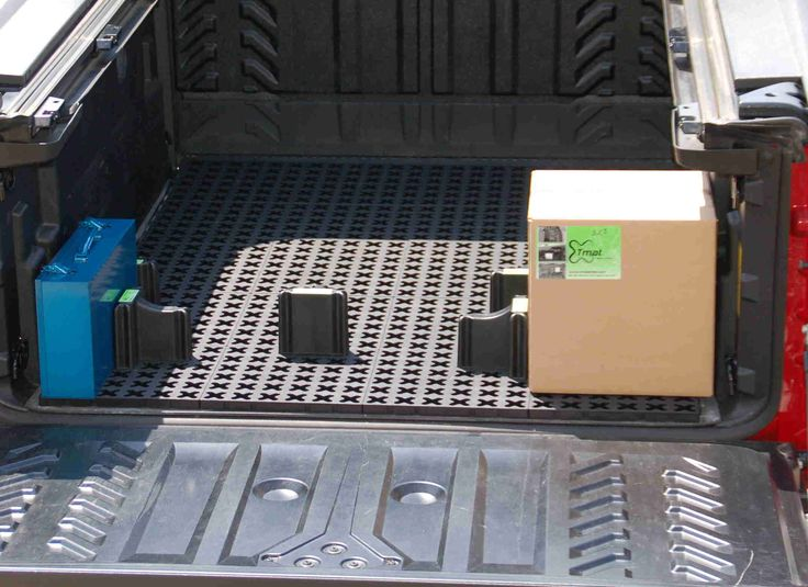 Tmatproducts.com.  Cargo mat that holds cargo in it's place!  Kits to fit any vehicle.