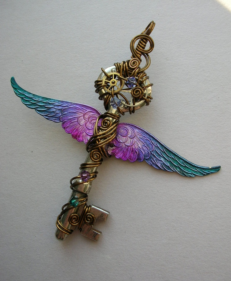 Winged Clockwork Key Pendant -- Steampunk Blue-Purple-Pink Inked Large Feathered Winged Key with Gears, Swarovski Crystals (A Key to Time). $80.00, via Etsy.