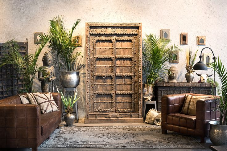 An antique 300 year old door armoire is the center piece of this living area.