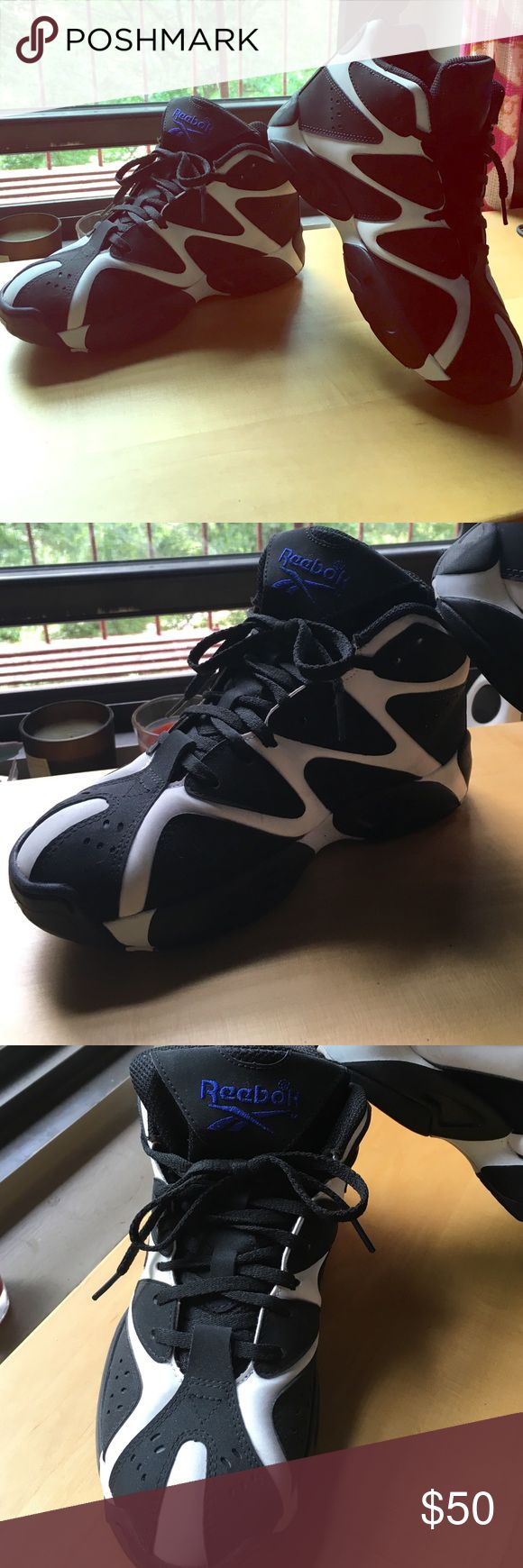 Reebok kamikaz These cute Reeboks are in amazing condition, only worn once. Black and white hightops pair well with leggings, shorts, and even dresses. They are a boys size 4, which equals women's size 6. Reebok Shoes Sneakers