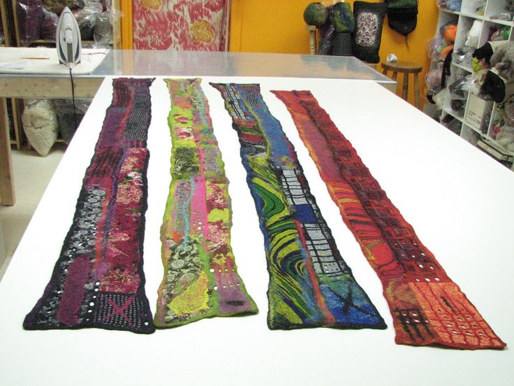 ANDREA GRAHAM, great site of a felting artist, aren't these scarves amazing? She has tutorials here, too.