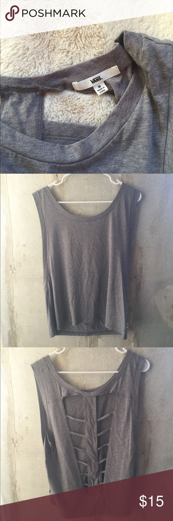 Vans cutout tank top New w/o tags. Purchased for Vegas but never got to using it. Super cute cut-out, perfect with a bandeau or bikini under. It's of a brown/grey color.. somewhere in between. Women's M. Vans Tops Tank Tops