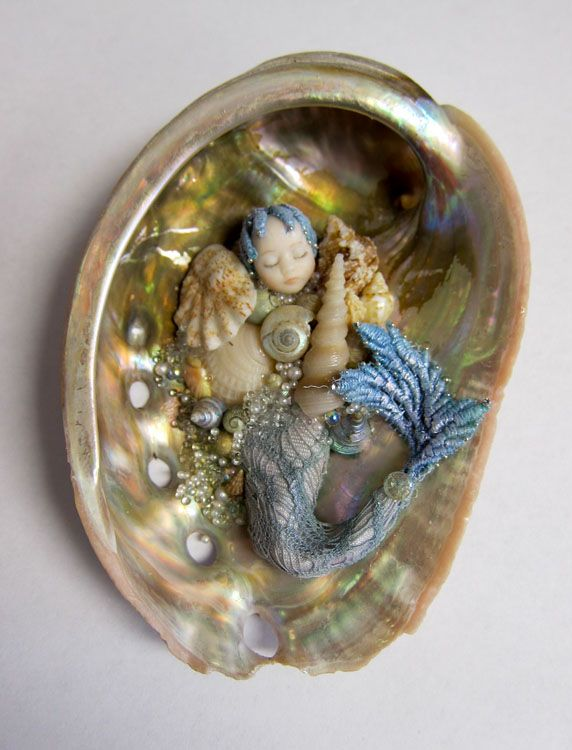 tiny mer-baby in shell