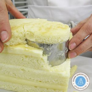 Remove excess cake around the cutter and continue to press the cutter through the cake.