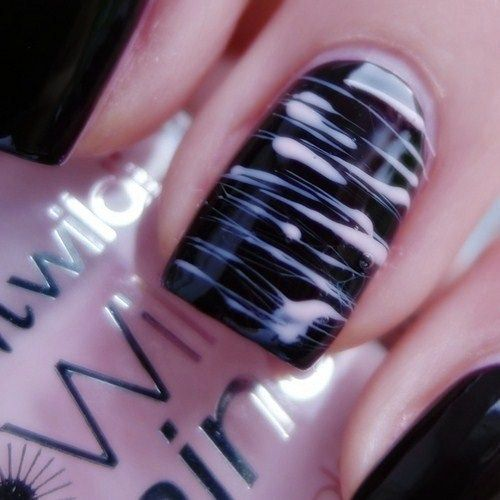 Nail art, pink and black manicure, stripes