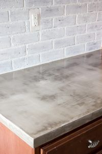 Whitewash faux brick paves for a backspash- DIY Feather Finish Concrete Countertops and How to Avoid a Huge Mistake | blesserhouse.com - A thorough step-by-step tutorial with useful tips and advice on what not to do.