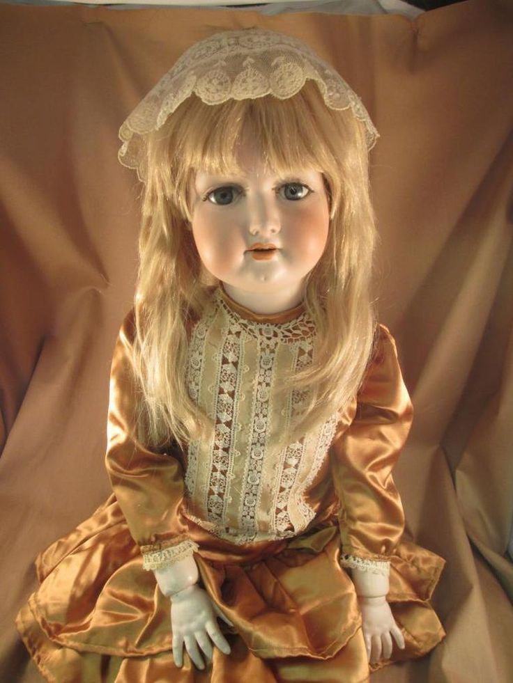 """German antique bisque child doll. No chips, cracks, or hairlines to the bisque. A & M #390. Composition jointed body has been repainted. Writing on paint on back shoulder. Measures roughly 36"""". Some cracks to body as shown. 