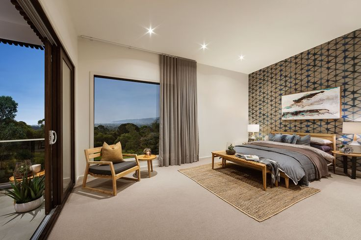 This Master bedroom is the perfect sanctuary for parents to enjoy. A vast space with a private balcony. #urbanedgehomes #masterbedroom #bedroom #melbournebuilder #home #interiors #interiordesign #balcony #wallpaper #alifewithstyle
