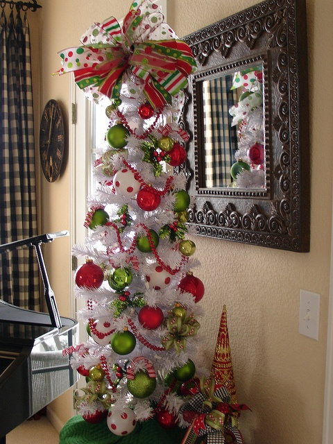 I love all of this tree but the bow on top...so wanting a white tree!