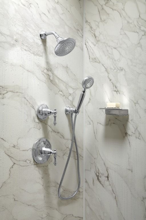 Choreograph shower walls give you the look of marble without the cost. http://www.us.kohler.com/us/Choreograph-Shower-Wall-and-Accessory-Collection/content/CNT116700120.htm?subSecId=CNT116700129