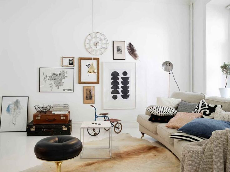 Living Room:Beige Fabric Sofa Dark Brown Furnished Wood Legs White Cube Small Coffee Table Grey Aluminum Base Black Leather Ottoman Chair Gold Painted Iron Fur Rug  Good Looking Scandinavian Living Room Decor