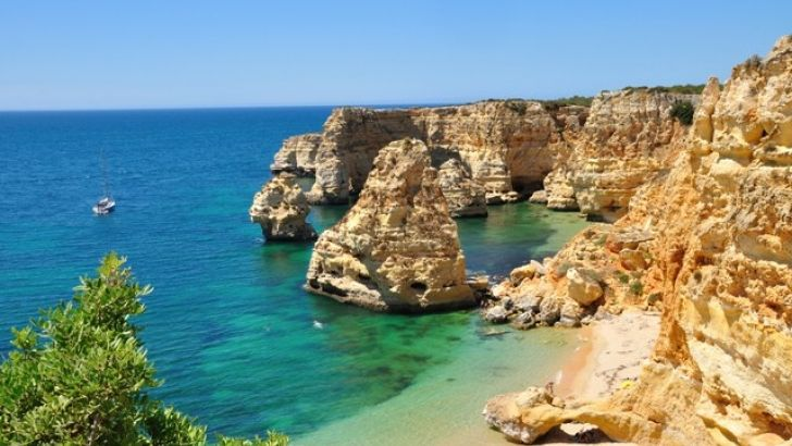 """Lagoa's Praia da Marinha beach has been named one of the """"best beaches in Europe"""" by online portal 'European Best Destinations'.  Praia de Miramar in Vila Nova de Gaia also made this year's list, which includes 15 of the """"most beautiful beaches of the European coastline"""", ideal for """"relaxing, partying or simply walking"""".  Placed sixth, Praia da Marinha is described as """"one of the most emblematic and beautiful beaches of Portugal … not only known for """"its beautiful cliffs, but also for the…"""