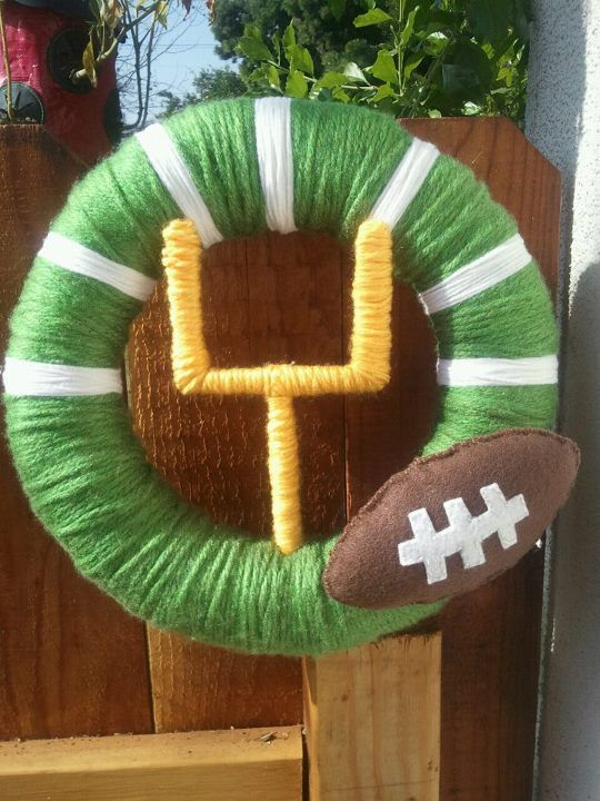 football wreath...mine was slightly different, and i added color ribbon for each super bowl team