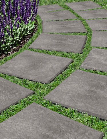 "Gardener's Supply: 12"" x 12"" Stomp Stones™ - Recycled Rubber Pavers: Drop & Stomp. Pavers resemble flagstones, but they're lightweight and much easier to carry and install than heavy stone or concrete pavers. Simply set them in place, step on them and the sharp beveled edge underneath cuts into grass, gravel, sand or soil, creating a stable, textured, non-slip surface"