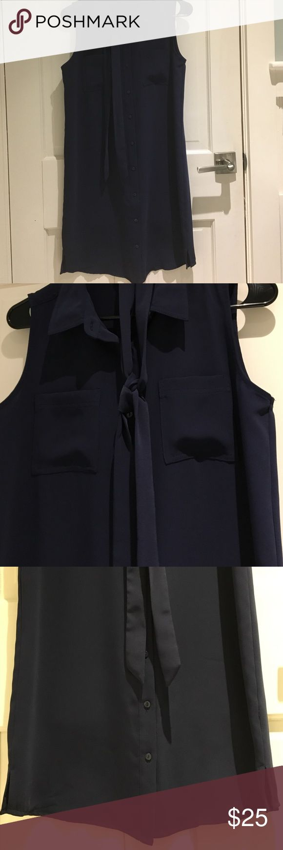 Adrienne Vittadini shirt dress size 4 Adrienne Vittadini shirt dress navy blue. Button down sleeveless with option to tie. Size tag came off but it's a size 4. 100% polyester. Never worn Adrienne Vittadini Dresses