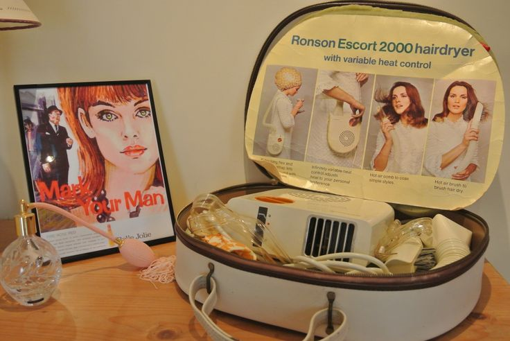 Powder room props: perfume bottle, a retro hairdryer and a Mad Men advert for lipstick.