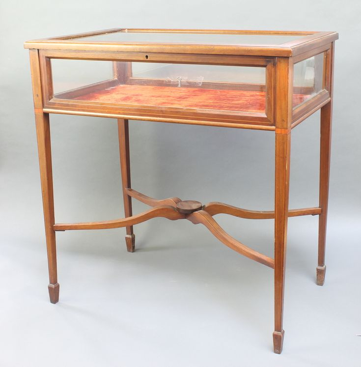 "Lot 850, An Edwardian crossbanded and inlaid rectangular bijouterie table, raised on square tapered legs 29""h x 27"" x 17 1/2""d, est £100-200"