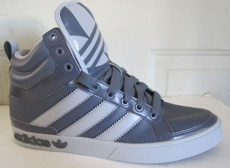 grey and blue adidas high tops