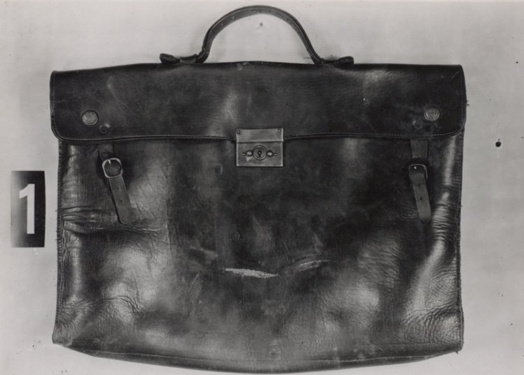Briefcase of Jozef Gabčík, abandoned at  the place of assassination attempt. Investigative officers found out that briefcase was before belonged to ladies' tailor, who sewed silk clothes. When Karel Čurda came to Gestapo, this briefcase was shown him among others, he recognized him and told that saw it in the home of Švatoš family. Mrs. Švatošová was ladies' tailor.